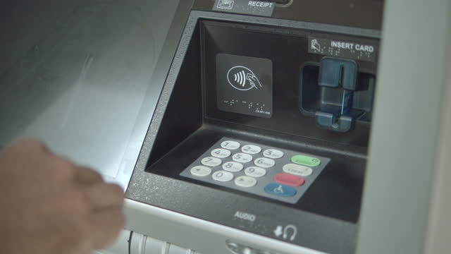 a man's hands as he does a transaction at an atm machine - home finances stock videos & royalty-free footage