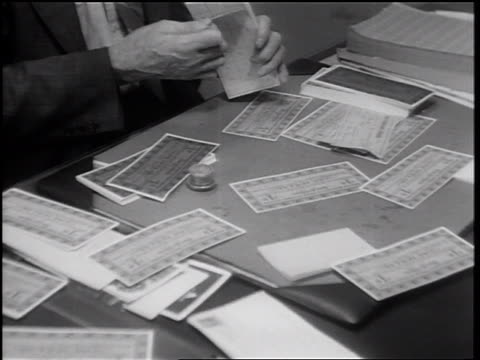 b/w 1932 man's hands examining scrip on cluttered desk / merced, california - 1932 stock videos & royalty-free footage