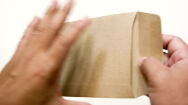 Man's hands holding envelope with blank paper