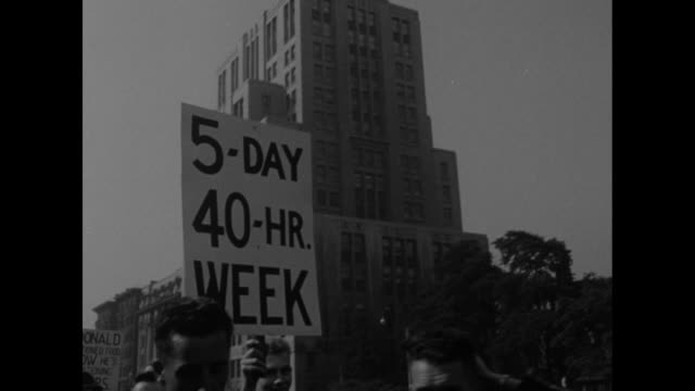 Man's hands holding pocket watch at 600 / VS men start march sign 'We are considered loyal ' / placard '5 day 40 hr week' 'Yes kiddies Your daddy...