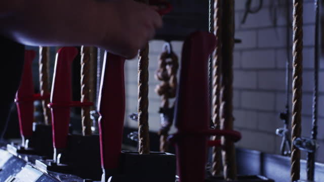 a man's hands release a backstage lever with ropes to raise a stage curtain. - rope stock videos & royalty-free footage
