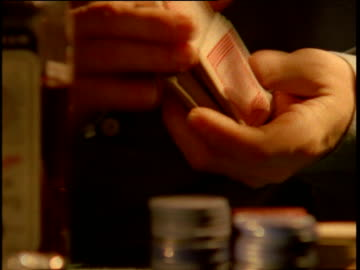 man's hands shuffle pack of cards at poker game - poker stock-videos und b-roll-filmmaterial