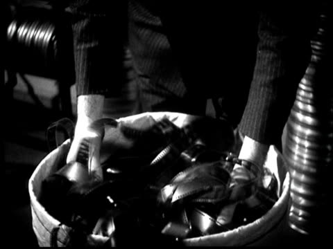 b/w cu 1936 man's hands taking film strip from trash can - stack stock videos & royalty-free footage