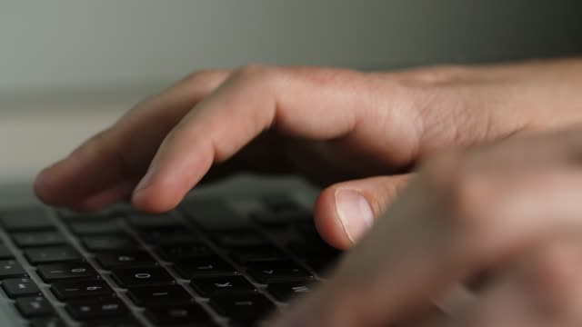 man's hands typing on a laptop - accessibility stock videos & royalty-free footage