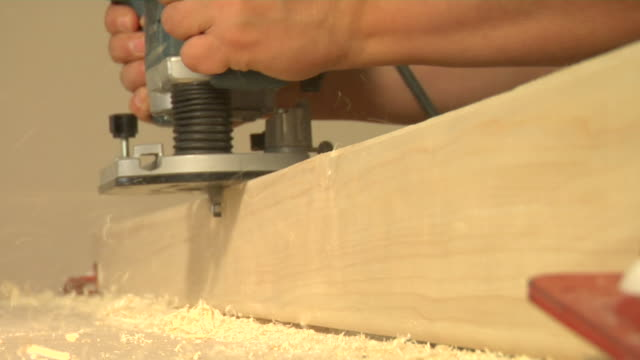 ecu man's hands using router, london, england - sawdust stock videos and b-roll footage