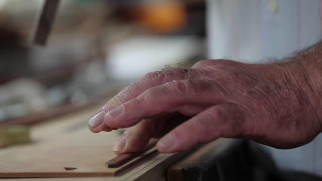 CU man's hands using tools