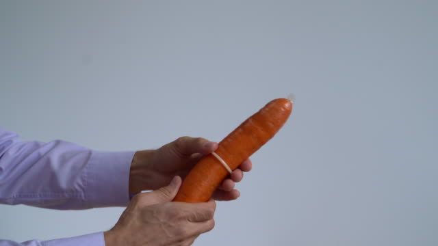 man`s hands wear a condom - condom stock videos and b-roll footage