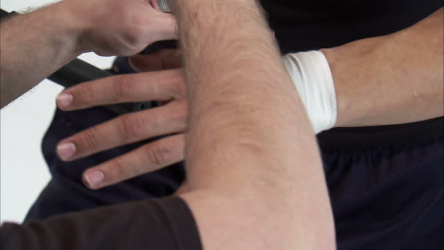 CU Man's hands wrapping boxer's hands with bandage / Orem, Utah, USA
