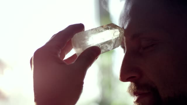 man's head with a healing crystal. - new age stock videos & royalty-free footage