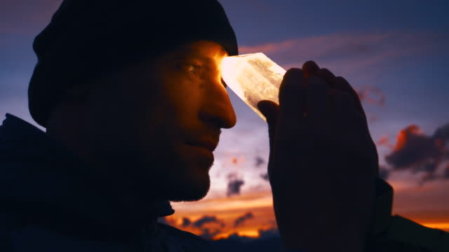 man's head with healing crystal during sunset - new age stock videos & royalty-free footage