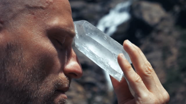man's head with healing crystal - new age stock videos & royalty-free footage