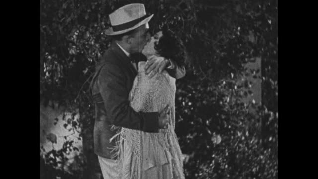 1932 man's (bing crosby) kisses have an unexpected affect on his date - 1932 stock-videos und b-roll-filmmaterial