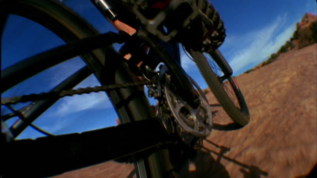 cu pov man's leg pedaling mountain bike / moab, utah, usa - moab utah stock videos and b-roll footage