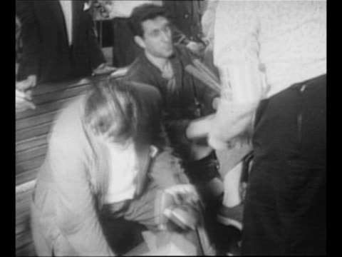 stockvideo's en b-roll-footage met man's legs as he walks barefoot after disembarking from ms stockholm at new york harbor with other survivors of the wrecked ss andrea doria / man... - blootvoets
