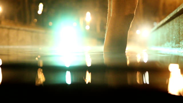 man's legs in thermal water at night - thermal pool stock videos & royalty-free footage