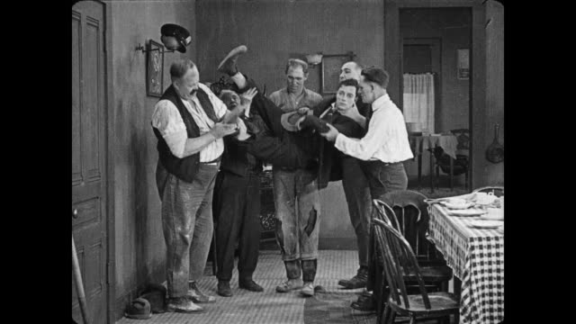 1922 Man's (Buster Keaton) new wife drags him home to meet her brothers who manhandle a bewildered Keaton