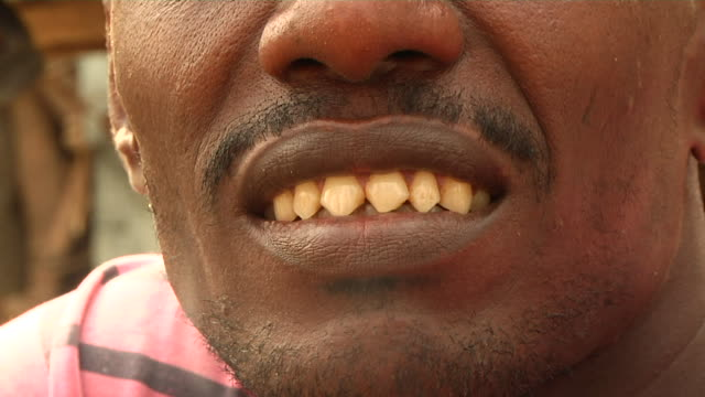 man's pointed teeth - one mid adult man only stock videos & royalty-free footage