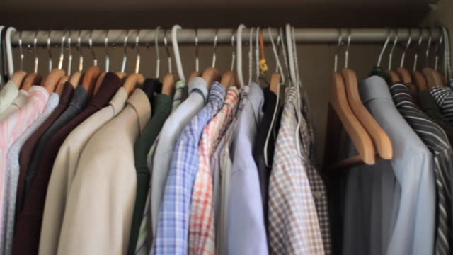 Man's shirts hanging on clothes rail