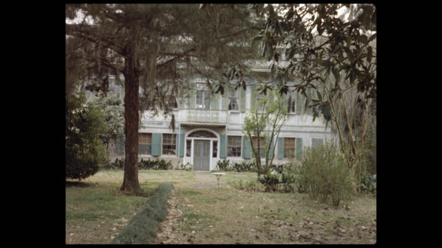 mansion and overgrown yard - 1960's - southern usa stock videos & royalty-free footage