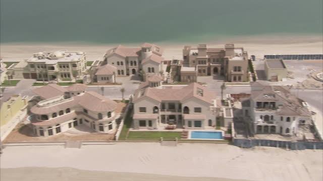 Mansions line a sandbar in Dubai.