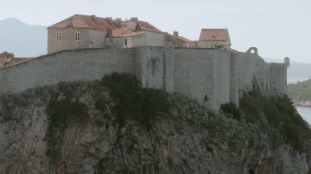 la mansion's stone wall wrapped around the edge of a hilltop / istanbul, turkey - stone wall stock videos and b-roll footage