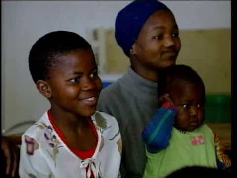 mants'ase children's home children from an aids orphanage in lesotho who met with prince harry on his visit there watching the itn documentary 'the... - 2004 stock-videos und b-roll-filmmaterial