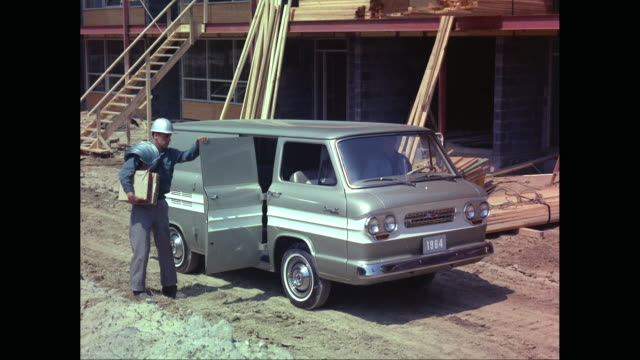 ms td manual worker getting down from van at construction site / united states - シボレー点の映像素材/bロール