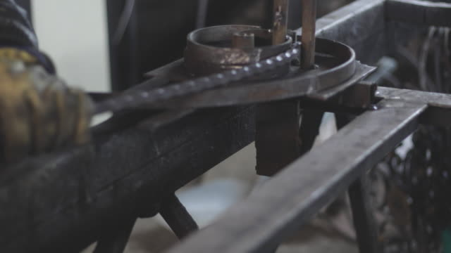 manual worker in a workshop - restoring stock videos and b-roll footage