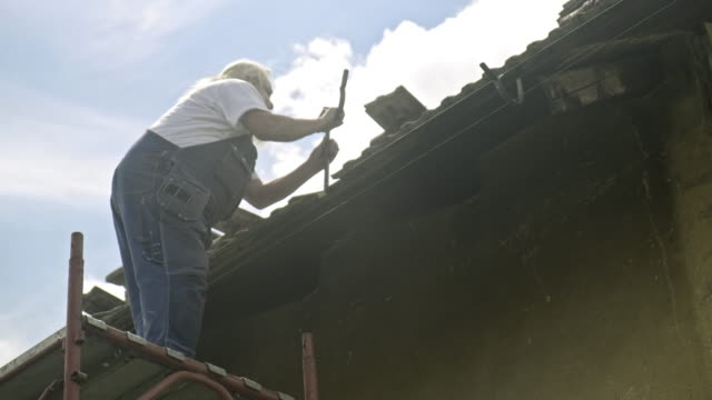 manual worker installing aluminium roof gutter - ladder stock videos & royalty-free footage