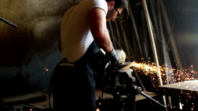 manual worker on a workshop - sparks stock videos & royalty-free footage