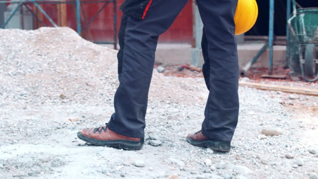 Manual worker standing on construction site