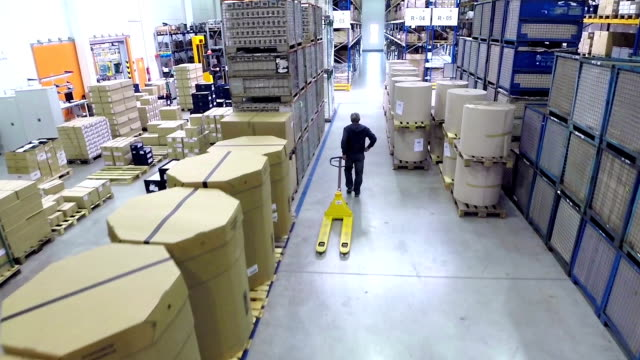 manual worker using pallet truck - warehouse stock videos and b-roll footage