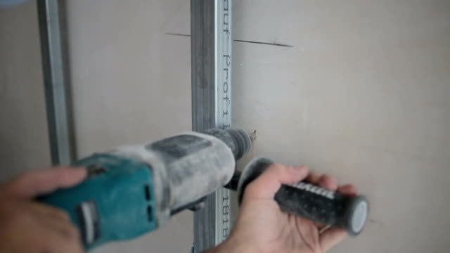manual workers drilling holes with drill in wall - toolbox stock videos and b-roll footage