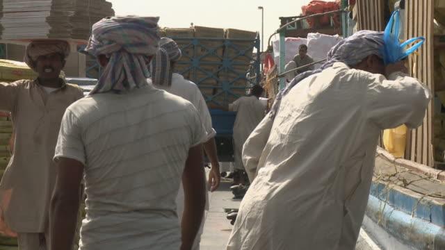 ms pan manual workers loading boat / dubai, united arab emirates - maintenance worker stock videos & royalty-free footage