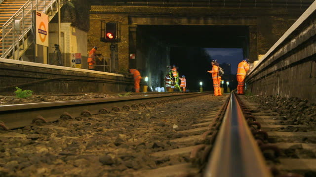 WS R/F Manual workers working on railroad track in Upper Holloway Rail Station / London, England, United Kingdom