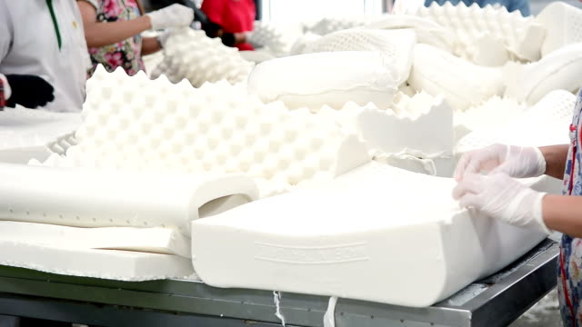 manuel worker working in production line of latex pillow factory - rubber stock videos & royalty-free footage