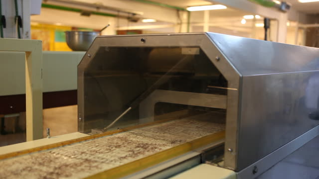 Manufactured chocolate products in the Chocolate factory 'Del Turista' in Bariloche in Patagonia on a conveyor belt
