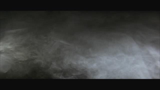 ms zi cu manufactured storm clouds at night - nebbia video stock e b–roll