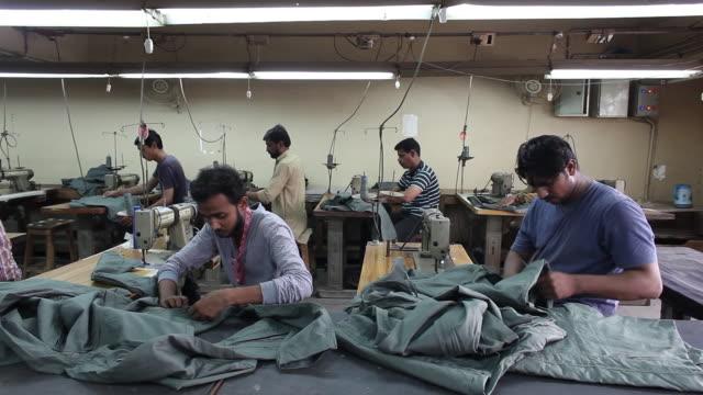 vídeos de stock e filmes b-roll de manufacturing military supplies at the lyra factory karachi sindh pakistan on thursday august 162018 - política e governo