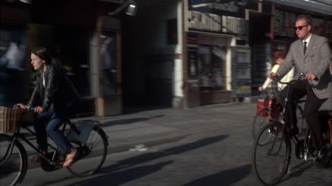 ms ts pan many bicycles on street in copenhagen  - copenhagen stock videos & royalty-free footage
