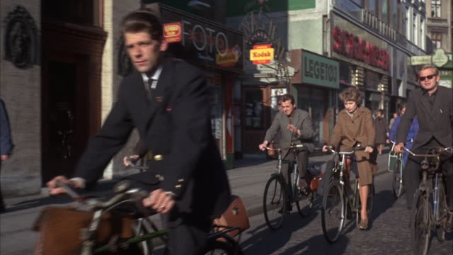 ms ts pan many bicycles on street in copenhagen  - 1965 stock videos & royalty-free footage