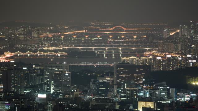 many bridges over han river and kangnam district at night, seoul, south korea - gruppo di oggetti video stock e b–roll
