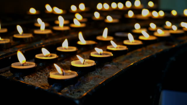 many burning candles with shallow in church - mourning stock videos & royalty-free footage