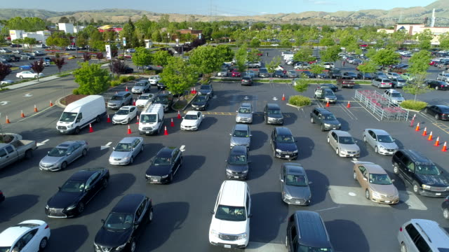 many cars are waiting in line at gas station. aerial view. - fuel pump stock videos & royalty-free footage