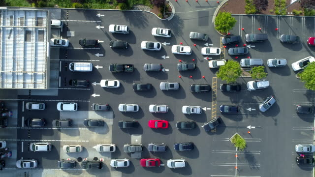 many cars are waiting in line at gas station. aerial view. - waiting in line stock videos & royalty-free footage