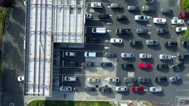 many cars are waiting in line at gas station. aerial view. - dividing line stock videos & royalty-free footage