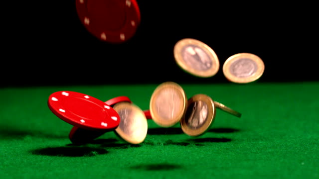 many chips and euro coins falling on casino table - money makes the world go around stock videos and b-roll footage