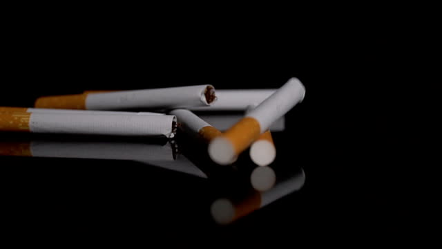 many cigarettes fall on a table - smoking issues stock videos and b-roll footage