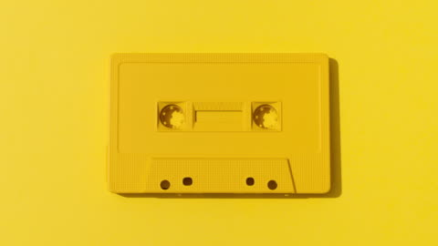 many colorful cassette tapes on multi colored backgrounds - man made object stock videos & royalty-free footage