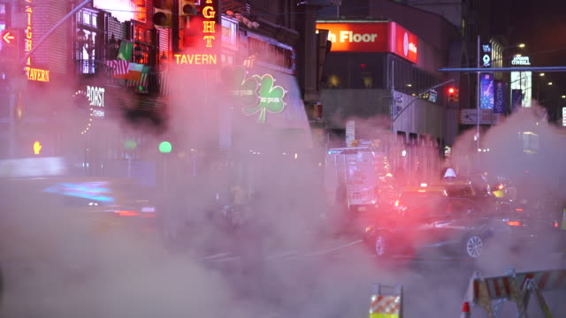 many colorful neon signs glow among the rising steam in the night around the times square in midtown manhattan new york city ny usa on jan. 14 2020. - yellow taxi stock videos & royalty-free footage